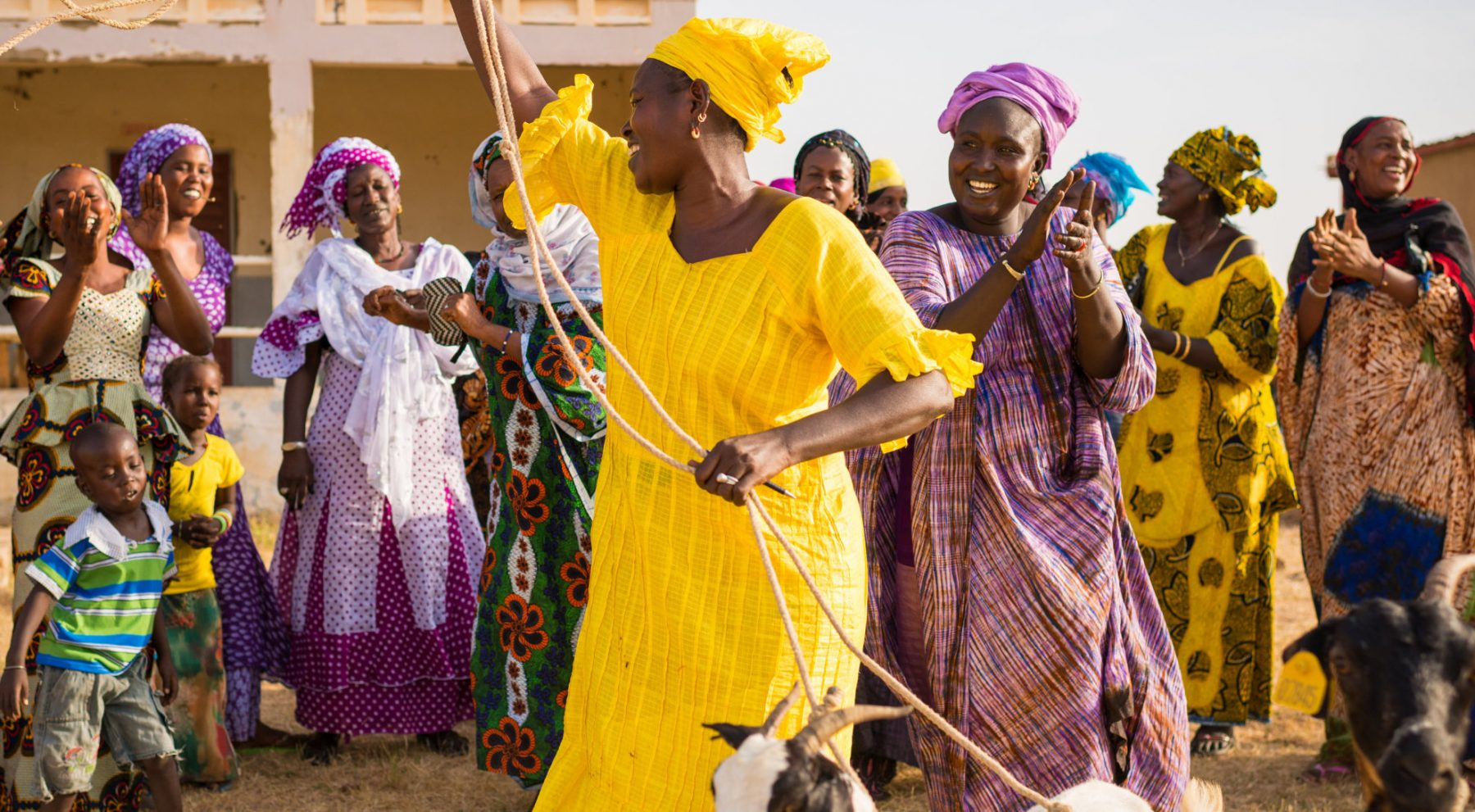 A group of women farmers dancing