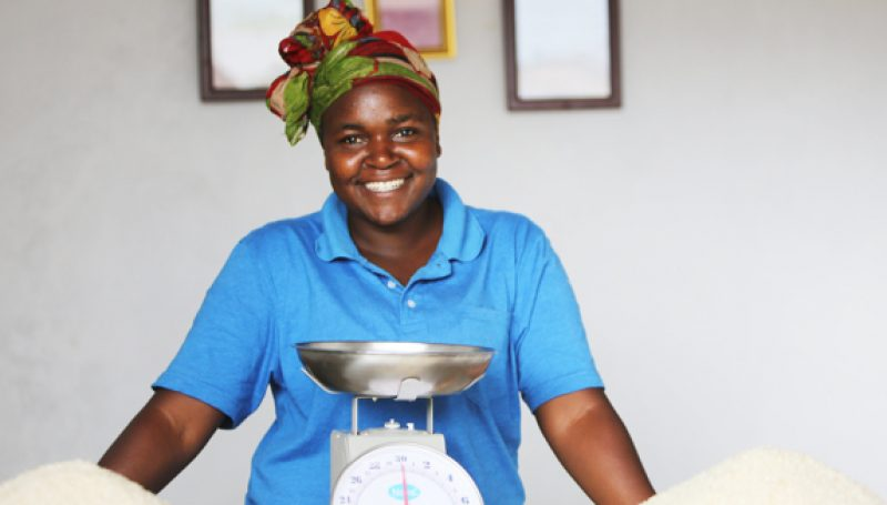 Women entrepreneur with her product and a scale